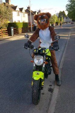 George MacIver, 55, dressed as a bear for a previous charity run.