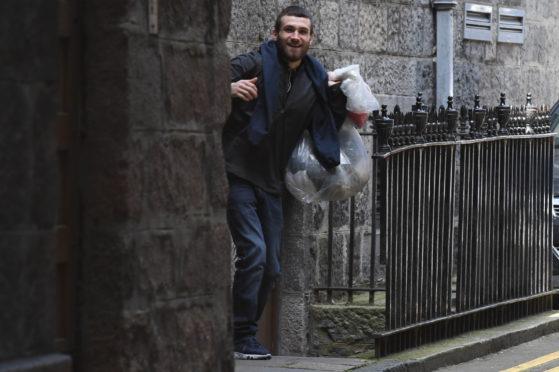 George Cowie leaving Aberdeen Sheriff Court