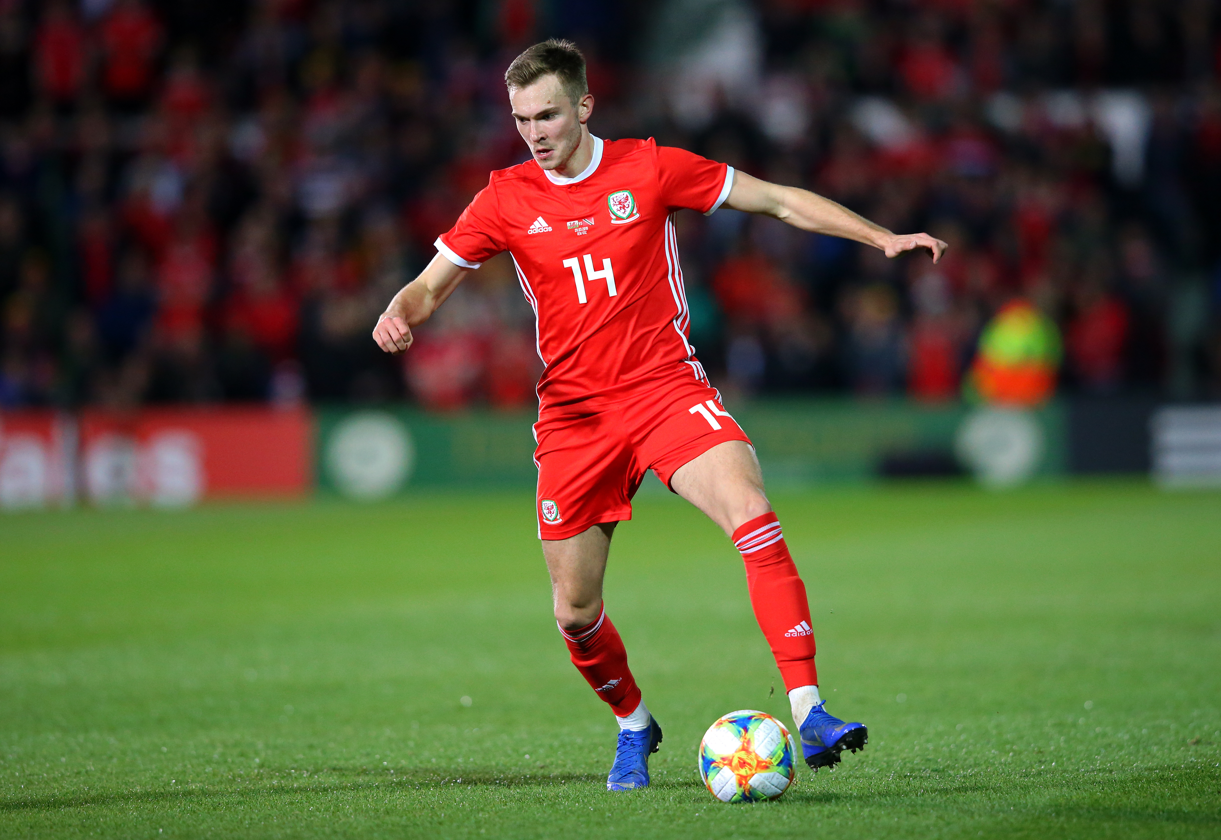 Ryan Hedges in action for Wales.