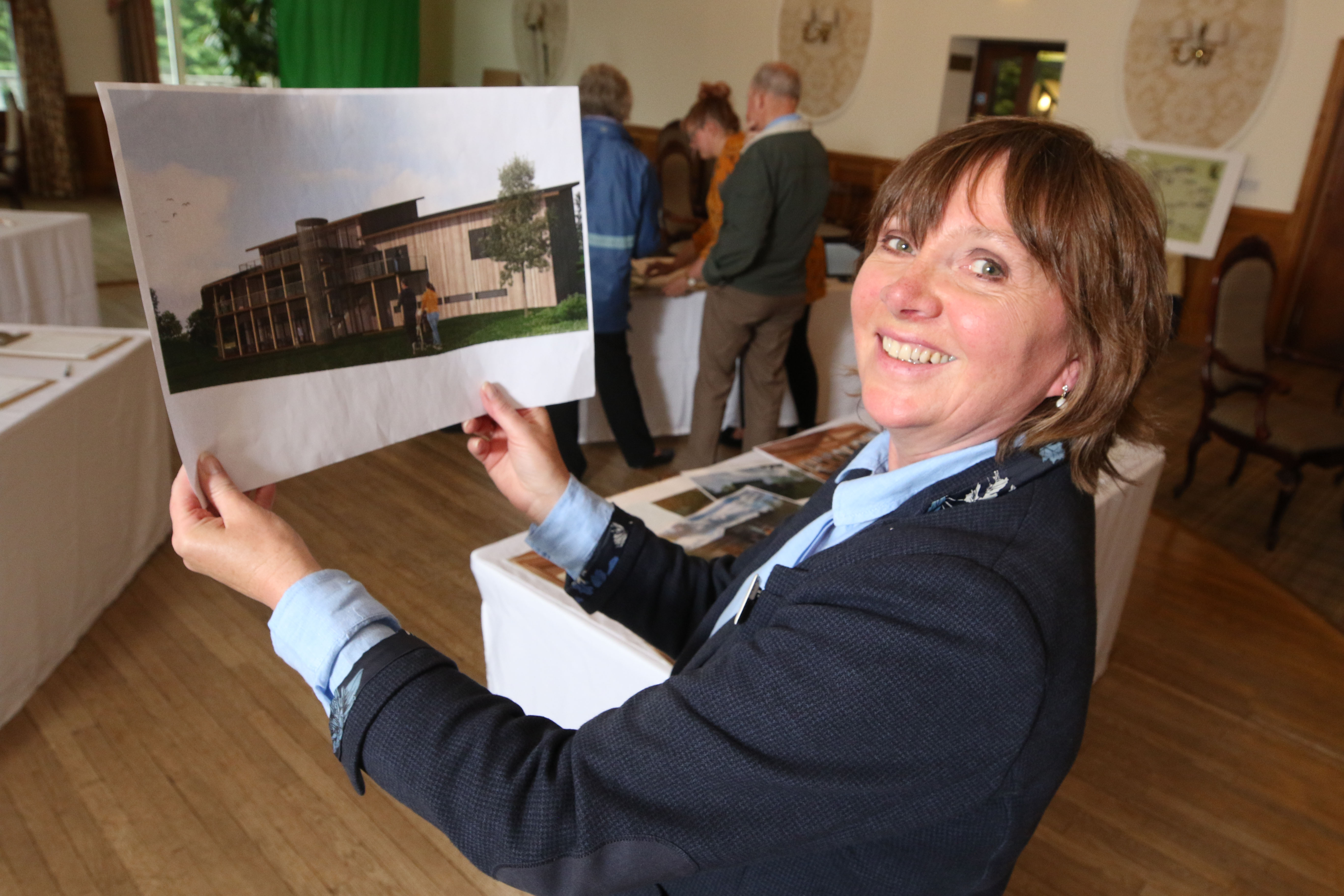 Highland Wildlife Park's head of operations Daska Mackintosh with an artist's impression of what a new visitors centre at the park would look like.