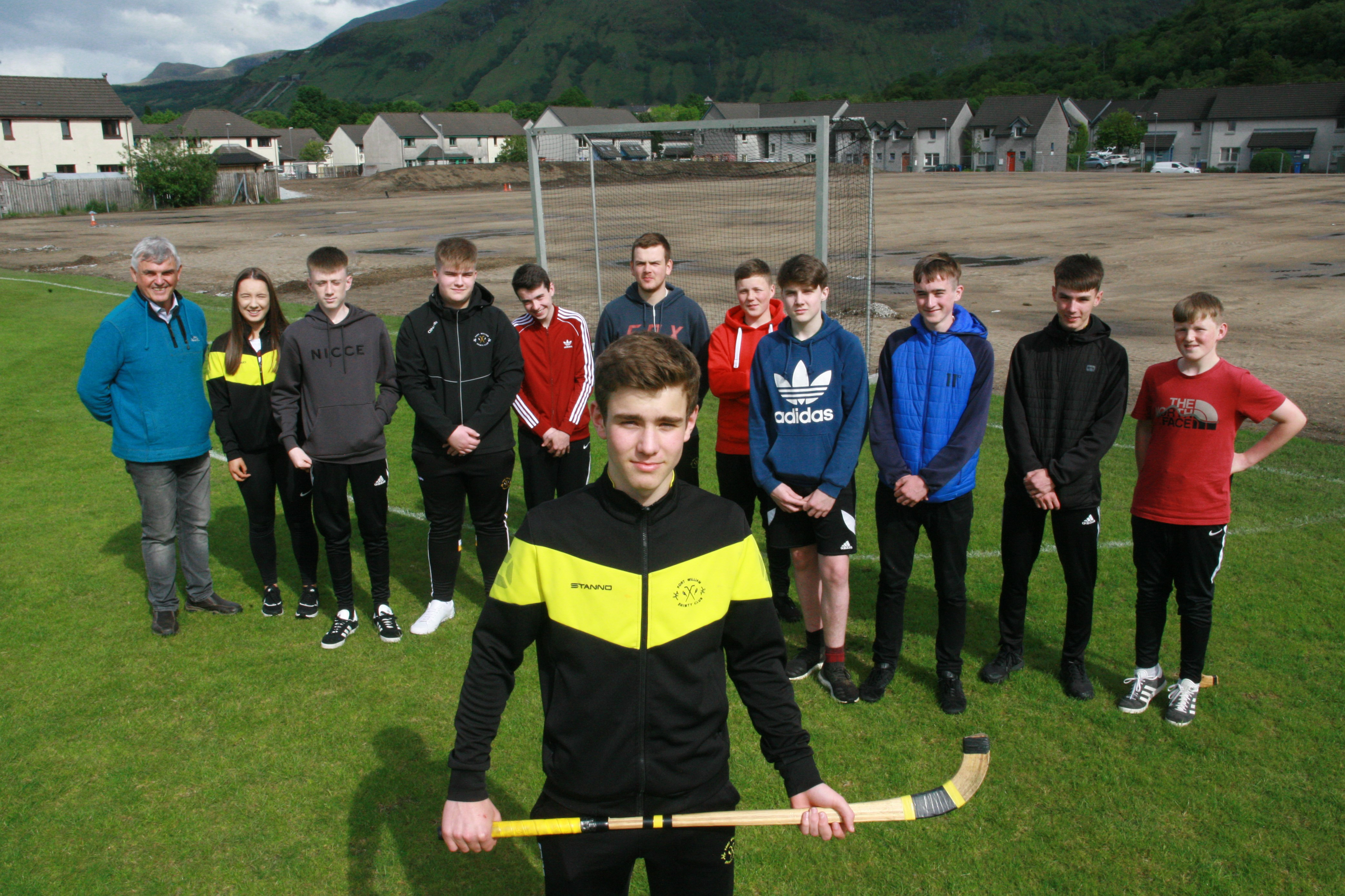 Richard Shaw Captain with the under 17s team of Fort William Shinty Club and officials