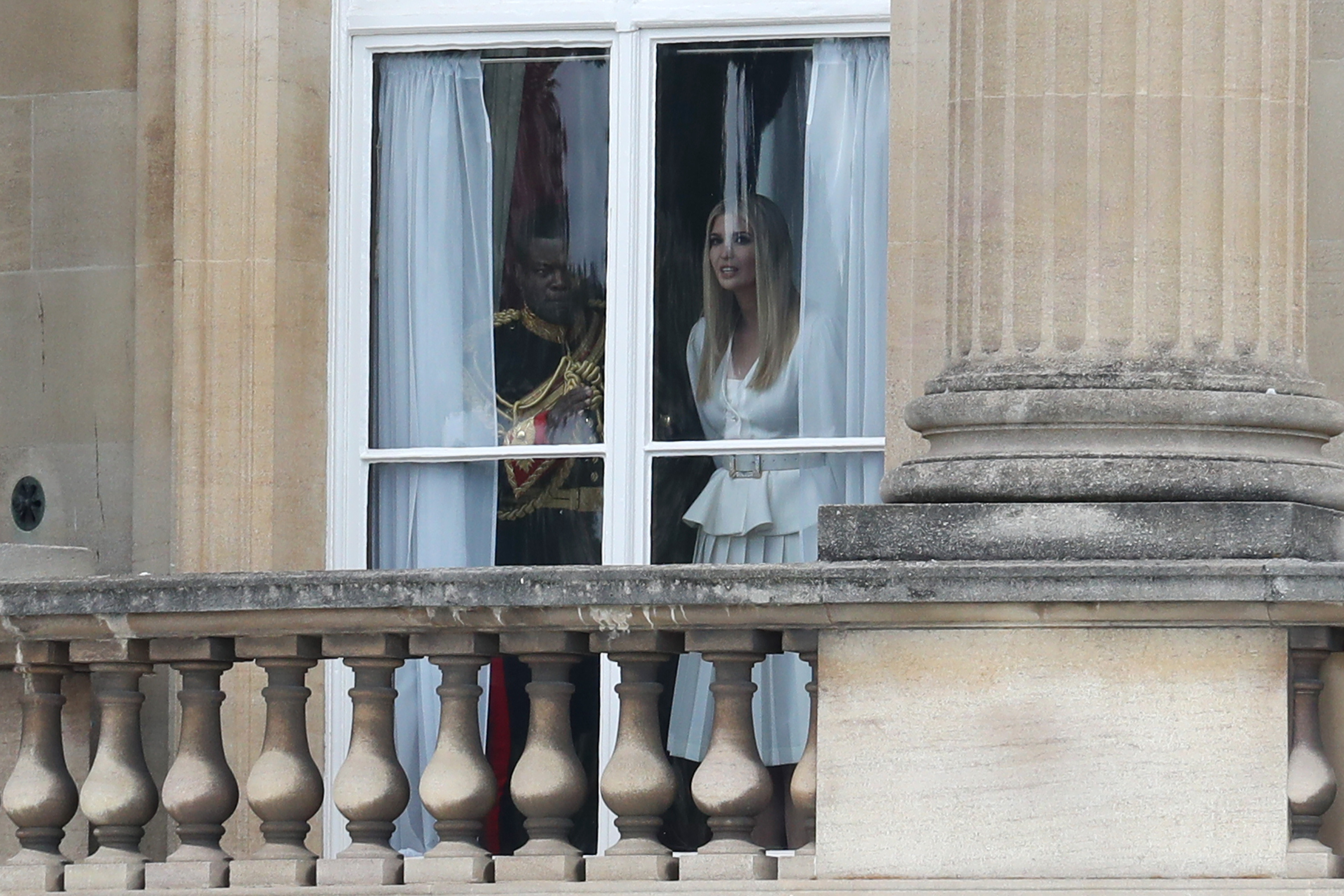LONDON, ENGLAND - JUNE 03: Ivanka Trump looks out of the window at Buckingham Palace ahead of the visit of US President Donald Trump and First Lady Melania Trump on June 03, 2019 in London, England. President Trump's three-day state visit will include lunch with the Queen, and a State Banquet at Buckingham Palace, as well as business meetings with the Prime Minister and the Duke of York, before travelling to Portsmouth to mark the 75th anniversary of the D-Day landings. (Photo by Chris Jackson/Getty Images)