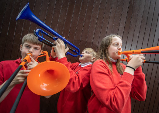 Zander Fleming, Kieran Powley and Callie Esson have all learned to play brass musical instruments on plastic equivalents.