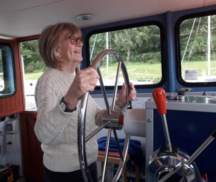 Nairn Contact the Elderly guest Frances takes to the helm on the Caledonian Canal outing