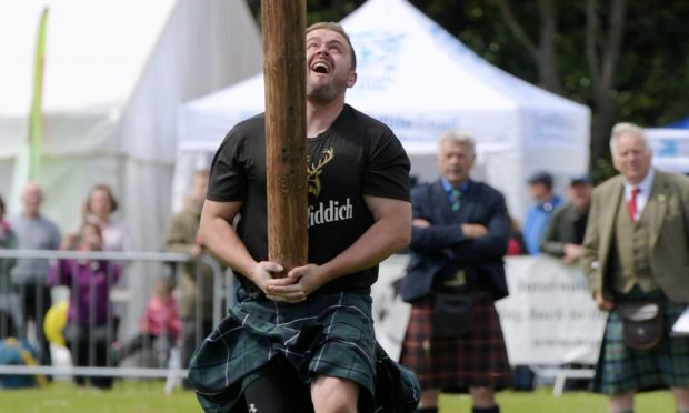 Tossing the Caber at 2019 Aberdeen Highland Games. Picture by Kath Flannery.
