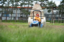 A grass cutter is pictured at Doocot Park in New Elgin.