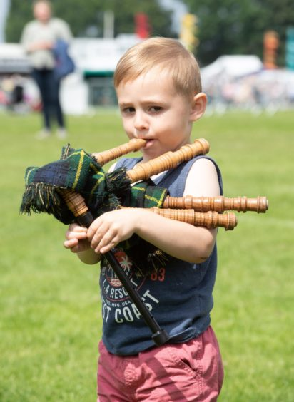 Sean Taylor from Pitlochry & Blair Atholl plays some mini bagpipes.  Pictures by JASON HEDGES