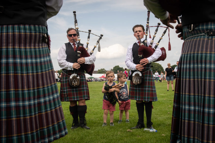 L2R - Christy Kelly, Sean and Eoghan Taylor and George White from Pitlochry & Blair Atholl Pipe Band.  Pictures by JASON HEDGES