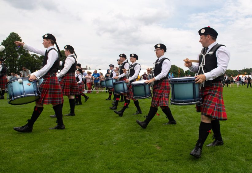 City of Discovery Pipe Band perform and get judged whilst a vibrant crowd look on.  Pictures by JASON HEDGES