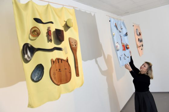 Dr Stacy Hunter with her exhibition.  Picture by Kenny Elrick