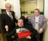 The Lachie Smith room in Inverness was opened yesterday by Deputy Provost Graham Ross (left) and May Smith, widow of Lachie with Ewan MacLeod of Ullapool who will benefit from the new facility.
