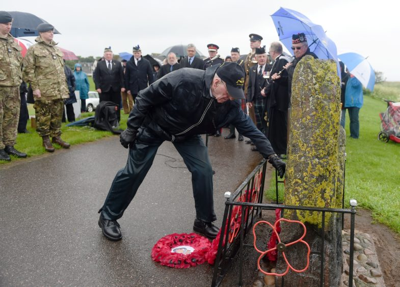 Former Submariner Bob Dingwall (88) of Inverness lays his wreath among others.