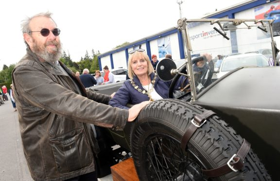 Provost Helen Carmichael who waved the cars off photographed with Mike Holt and his 1922 Vauxhall 23/60.