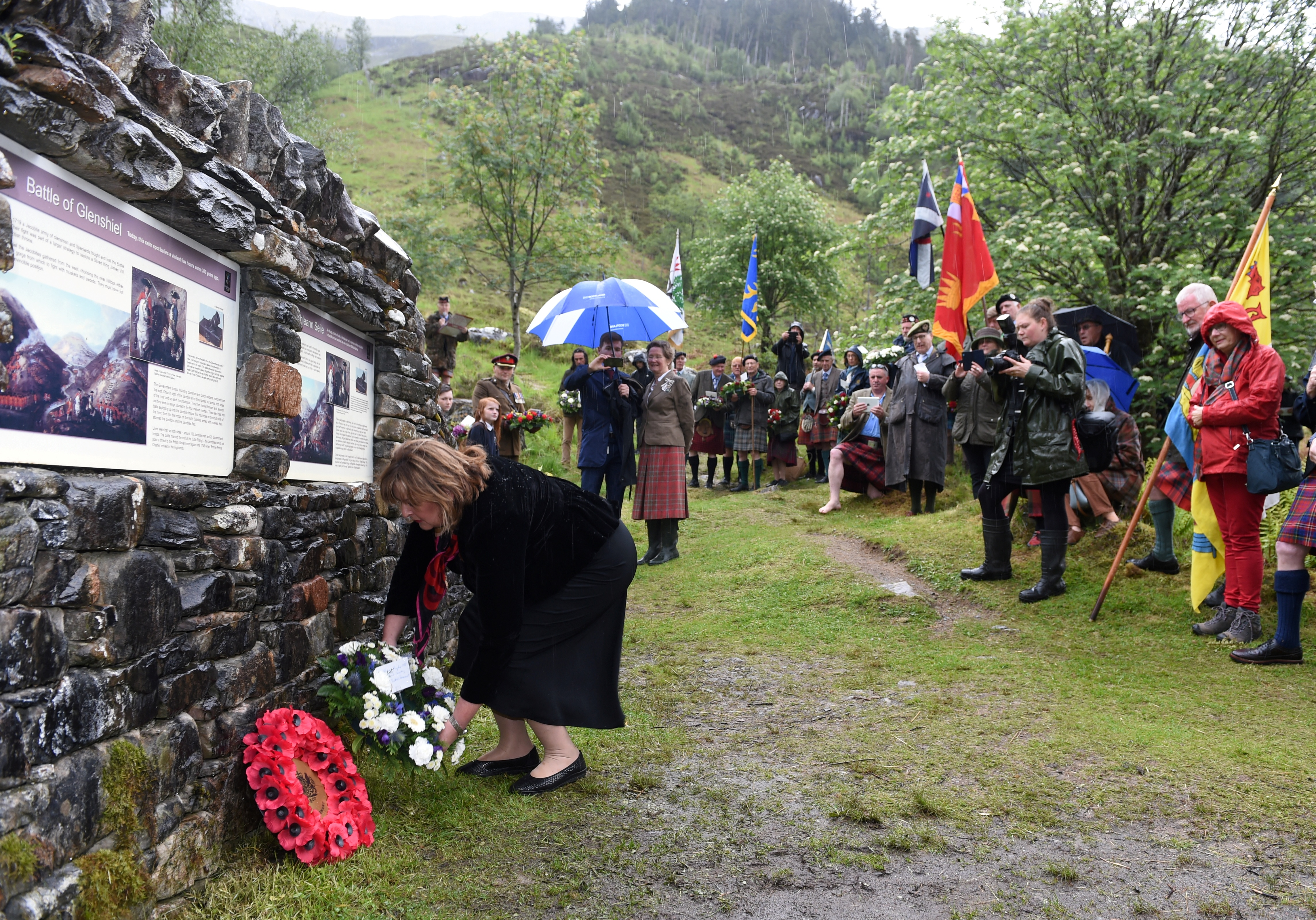 Cabinet Secretary Fiona Hyslop lays her wreath at the tercentenary commemoration of the Battle of Glenshiel.