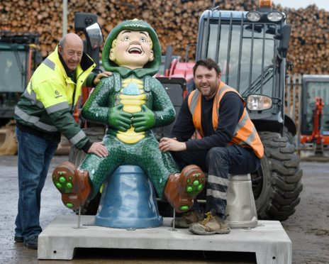 """The """"Oor Wullies"""" which are to grace Inverness arrived in the city on Thursday morning ahead of positioning this weekend. Delivery driver Ron Shearer (left) of Northwards Transport and plant operator Ronnie Lundie of Morris Lesley unload the statues in Inverness. Picture by Sandy McCook"""