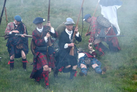 Battle re-enactment at the Highland Folk Museum, Newtonmore as members of the Alan Breck's Prestonpans Volunteer Regiment play the roles of the Edinburgh City Guard and also the Jacobites.