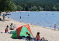 Sun bathers and children enjoy the waters and sandy beach of Loch Morligh in Strathspey in the shadow of Cairngorm. Picture by Sandy McCook