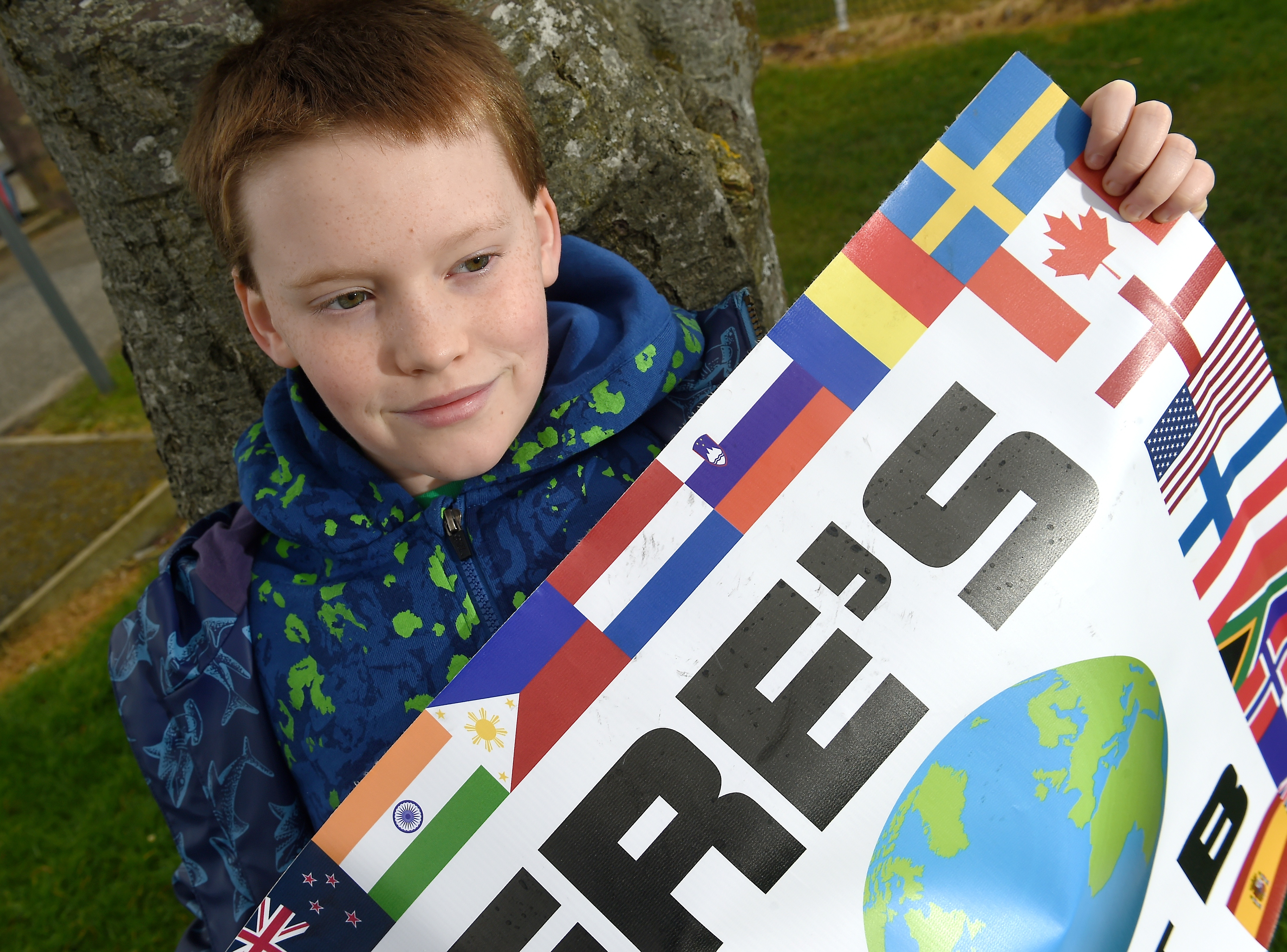 Finlay Pringle (11) photographed outside the school during one of his strikes in aid of climate concerns. Picture by Sandy McCook.