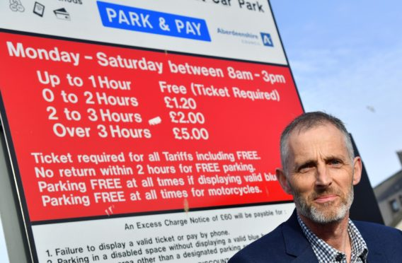 PETERHEAD BID CHAIRMAN JOHN PASCOE IS CONCERNED OVER THE WITHDRAWAL OF THE 1 HOUR FREE PARKING IN COUNCIL CAR PARKS.