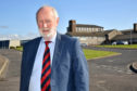 CLLR AND FORMER TEACHER CHARLES BUCHAN WEARING HIS SCHOOL TIE AT FRASERBURGH ACADEMY.