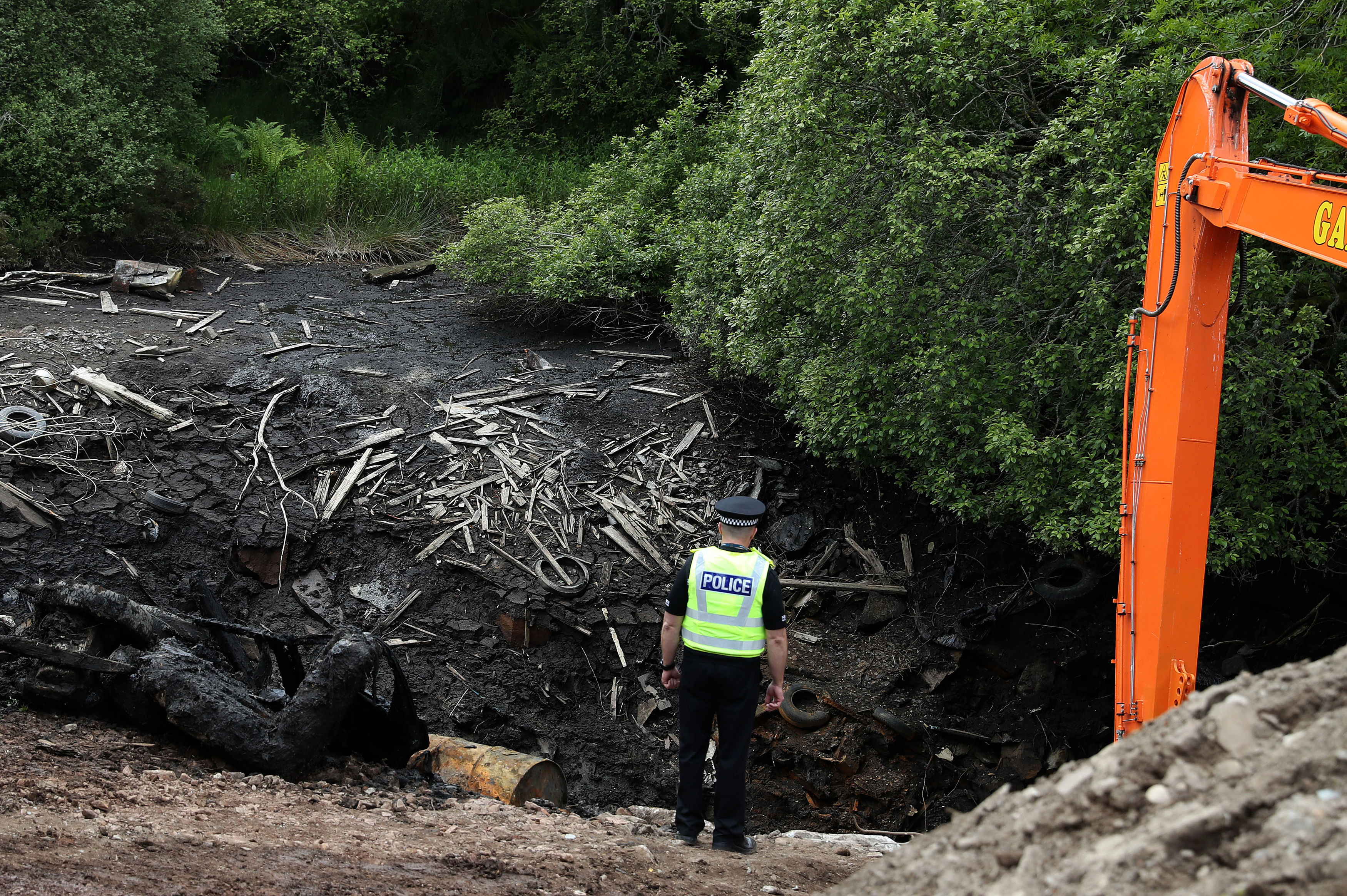 A Police officer at the emptied Leanach Quarry near Inverness