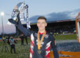 Ross County's Josh Mullin parades the Championship trophy.