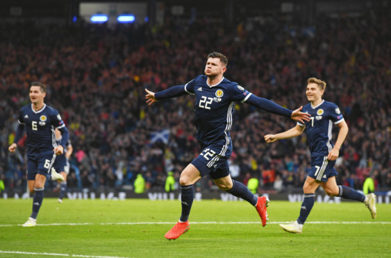 Scotland's Oliver Burke celebrates his late goal against Cyprus earlier this year.