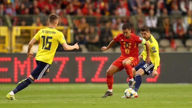 Belgium's Eden Hazard (centre) in action with Scotland's Scott McTominay (left) and Kenny McLean.