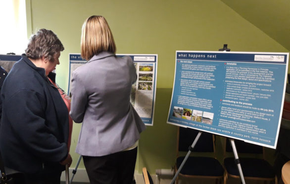 Residents inspect the plans