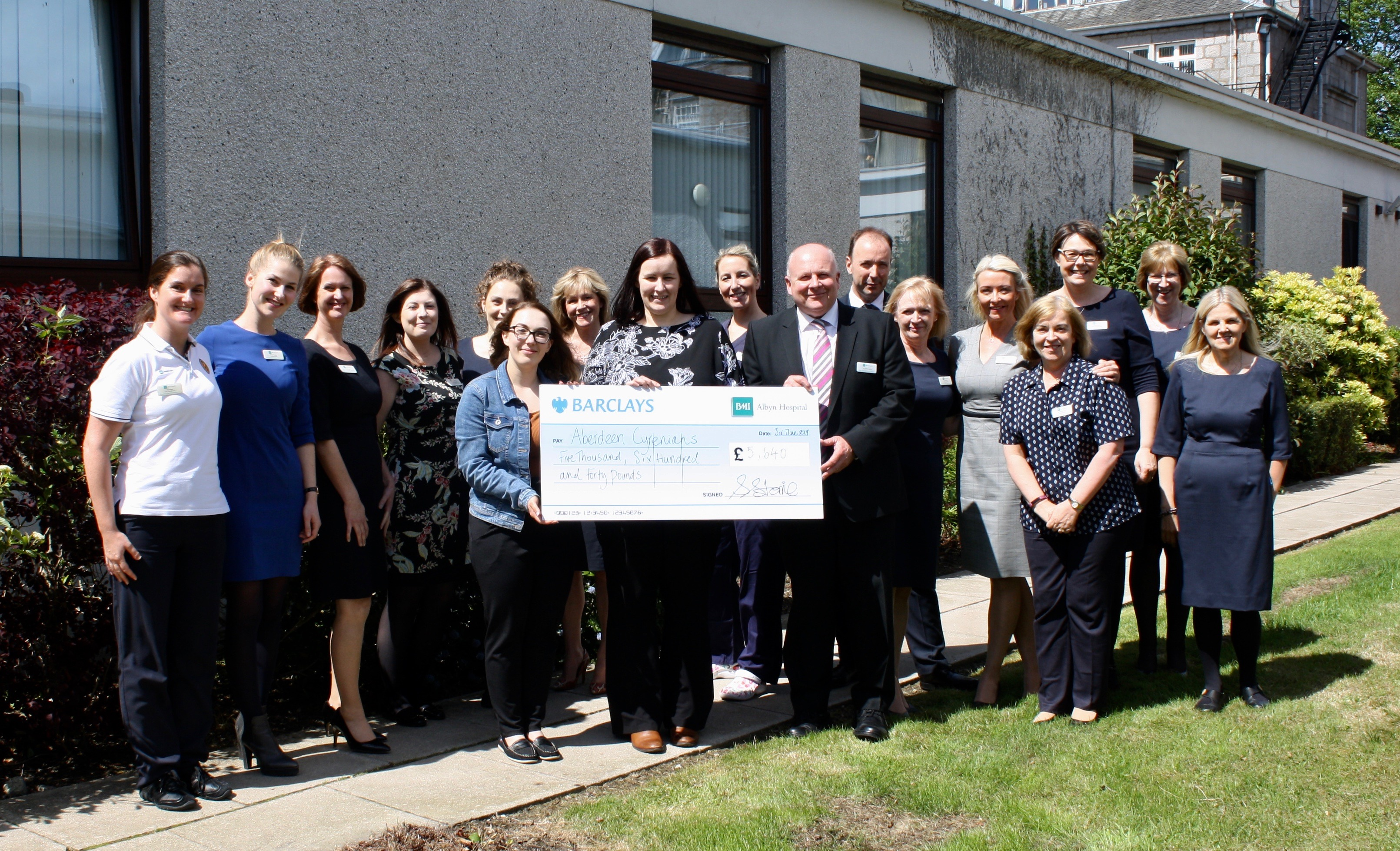 Hospital staff gift a £5,620 cheque.