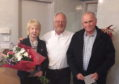 Community council chairman Bill Pitt between retiring members Barbara Anderson and Gordon Davidson