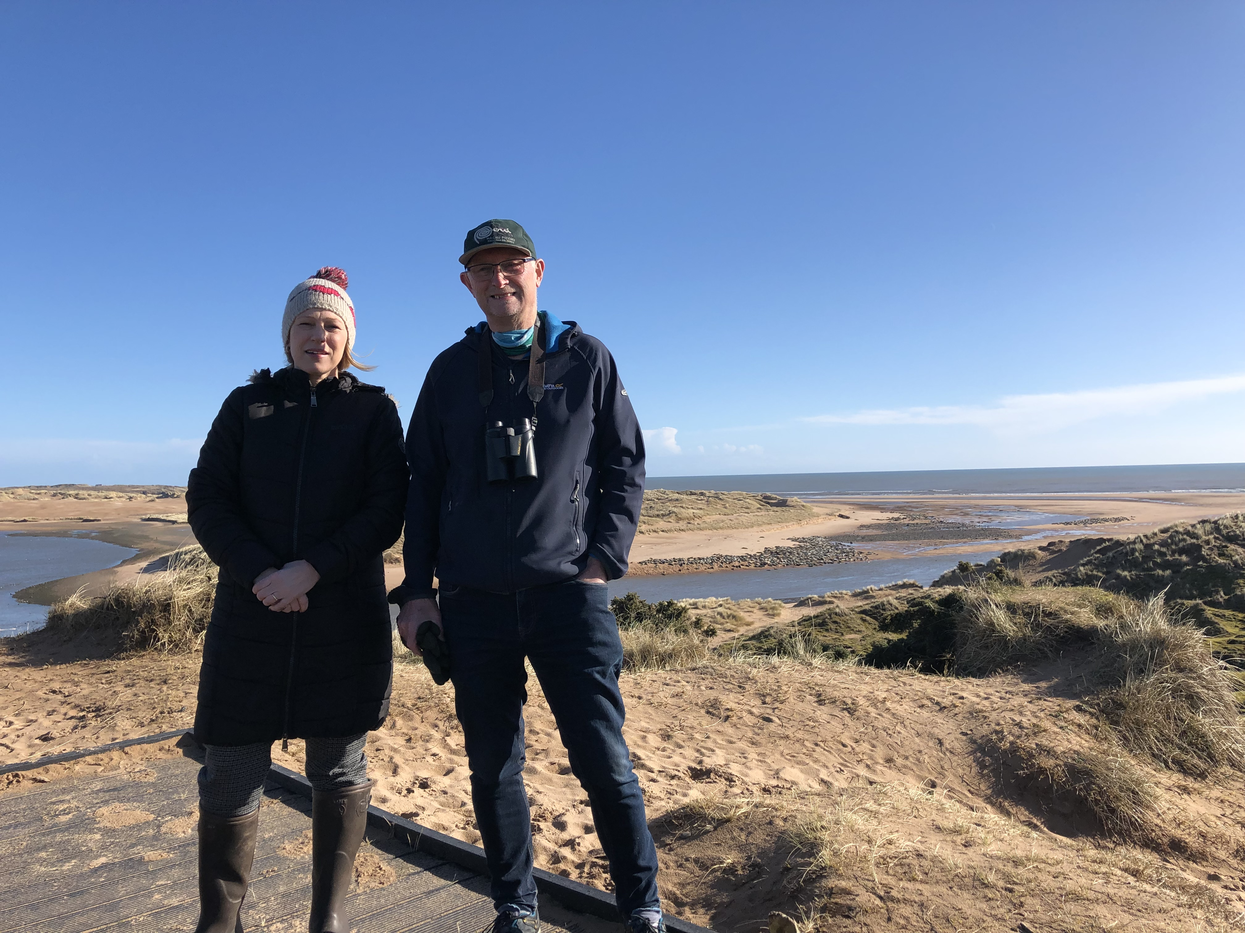 Picture of Gillian Martin MSP with Heads Up for Seals' Project manager Ron Macdonald at Newburgh Beach