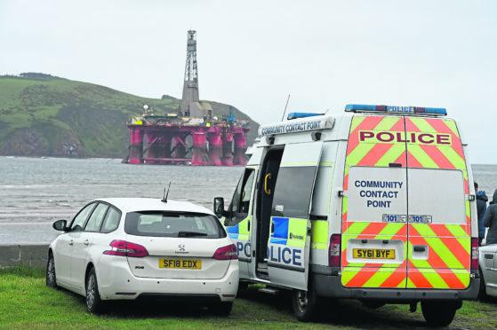 Police at the scene near the Greenpeace-occupied rig, Paul B Lloyd Jr