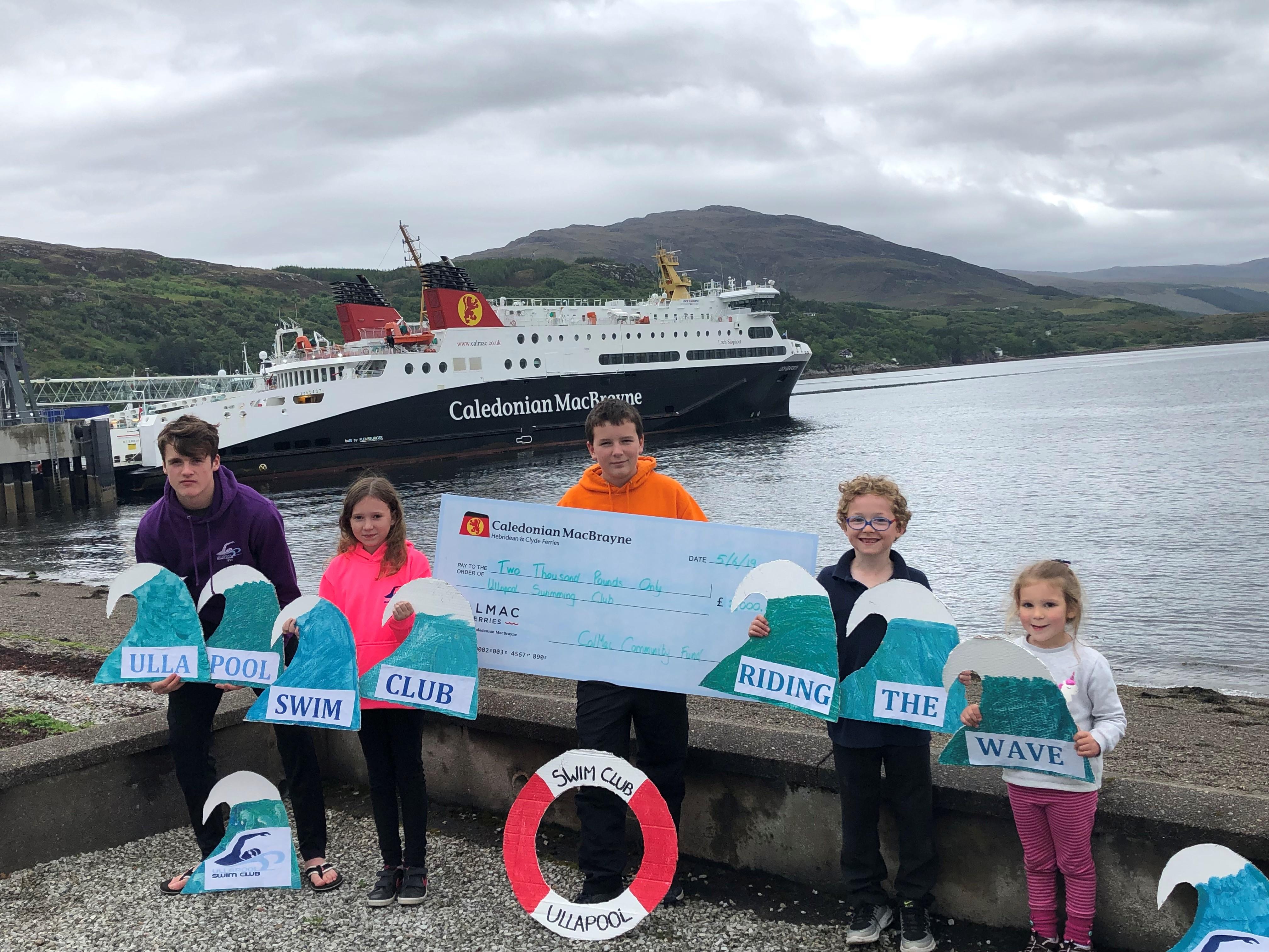 Junior members of the Ullapool Swim Club show off their CalMac Community Fund cheque.