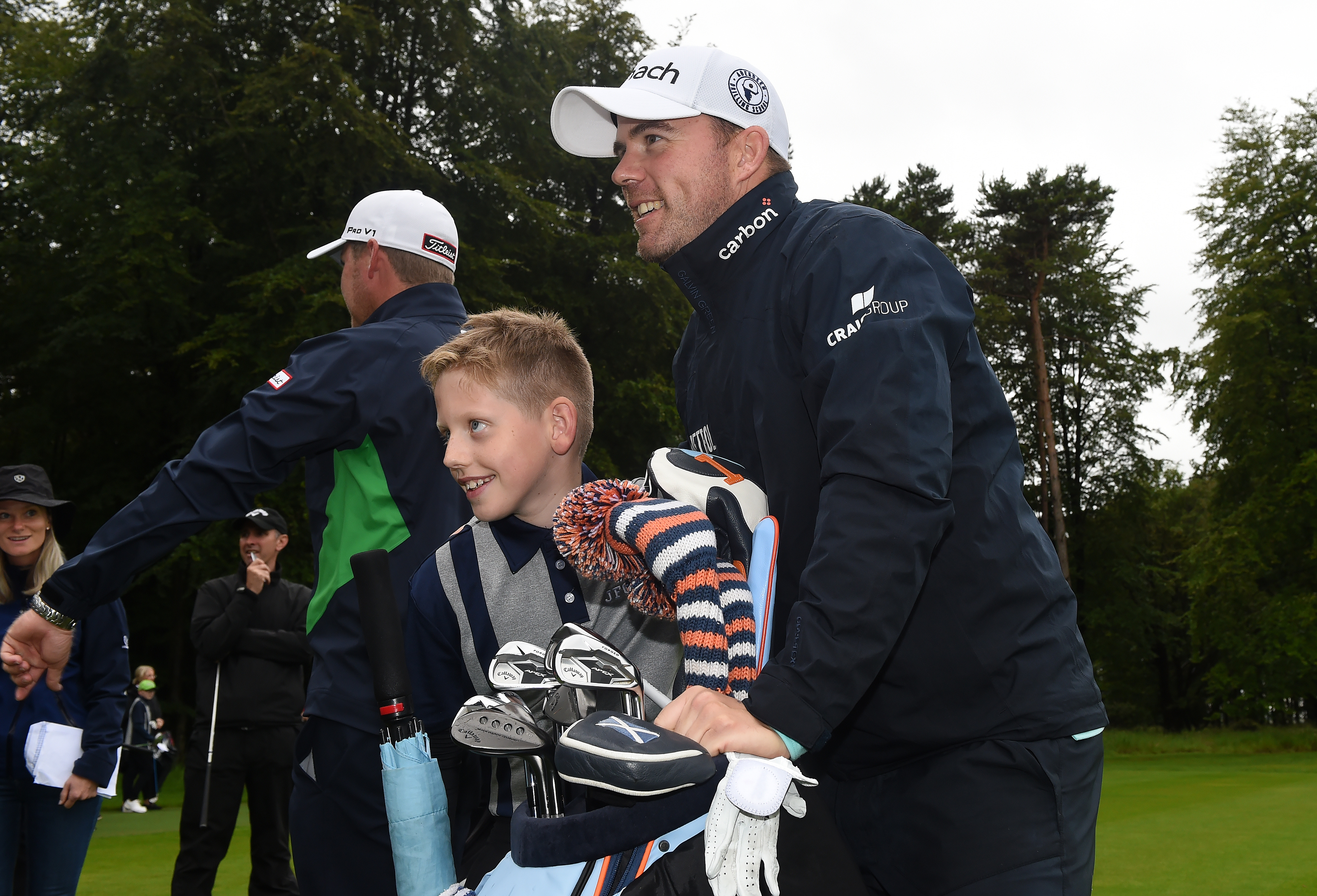 Richie Ramsay poses with local children during a golf clinic at the Aberdeen Standard Investments Scottish Open at The Renaissance Club.