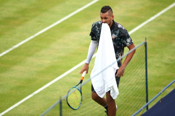 LONDON, ENGLAND - JUNE 20: Nick Kyrgios of Australia reacts during his First Round Singles Match against Roberto Carballes Baena of Spain during day Four of the Fever-Tree Championships at Queens Club on June 20, 2019 in London, United Kingdom. (Photo by Clive Brunskill/Getty Images)