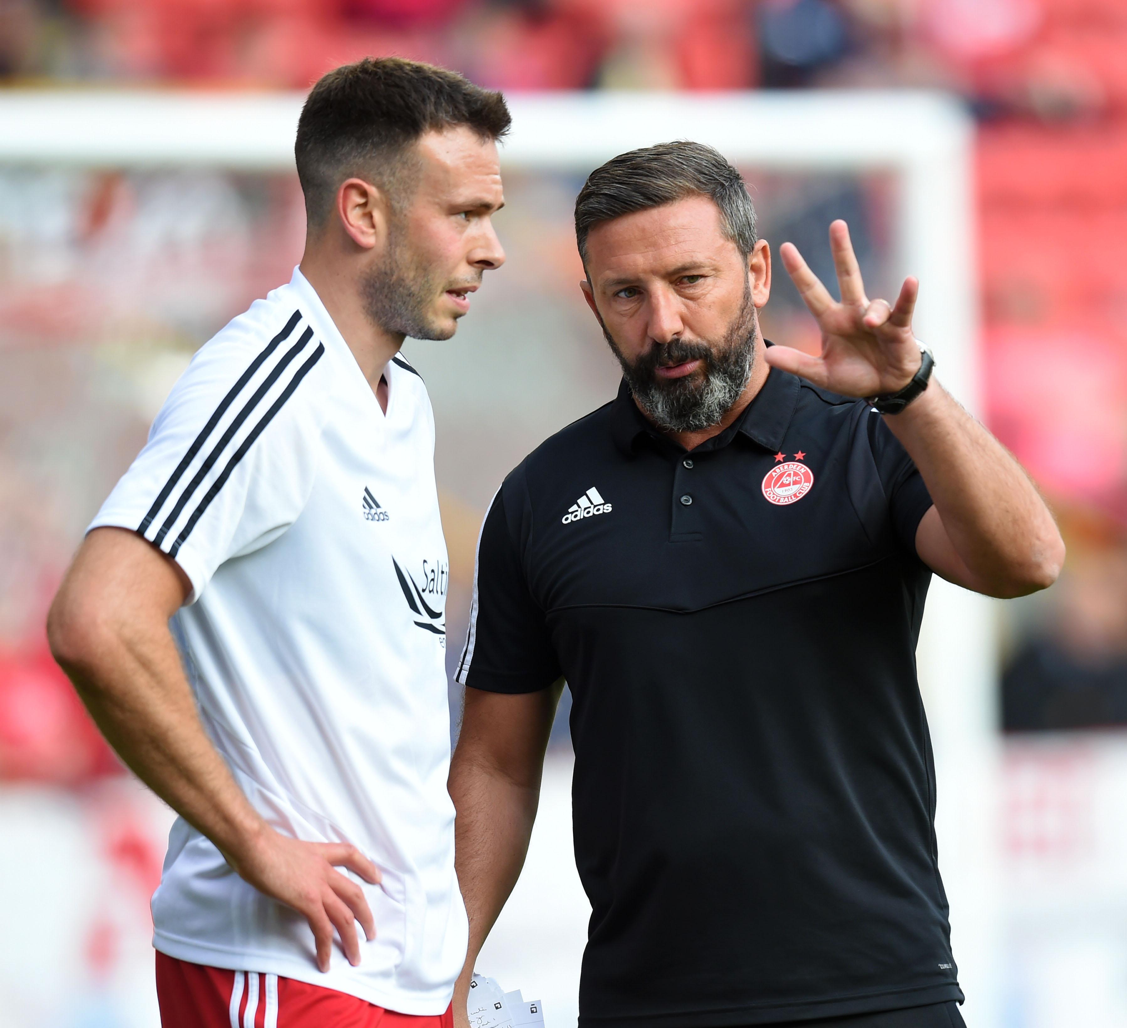Aberdeen manager Derek McInnes issues instructions to Andrew Considine