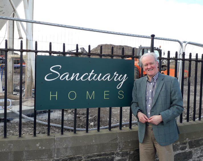 MSP Stewart Stevenson at the development site in Portsoy