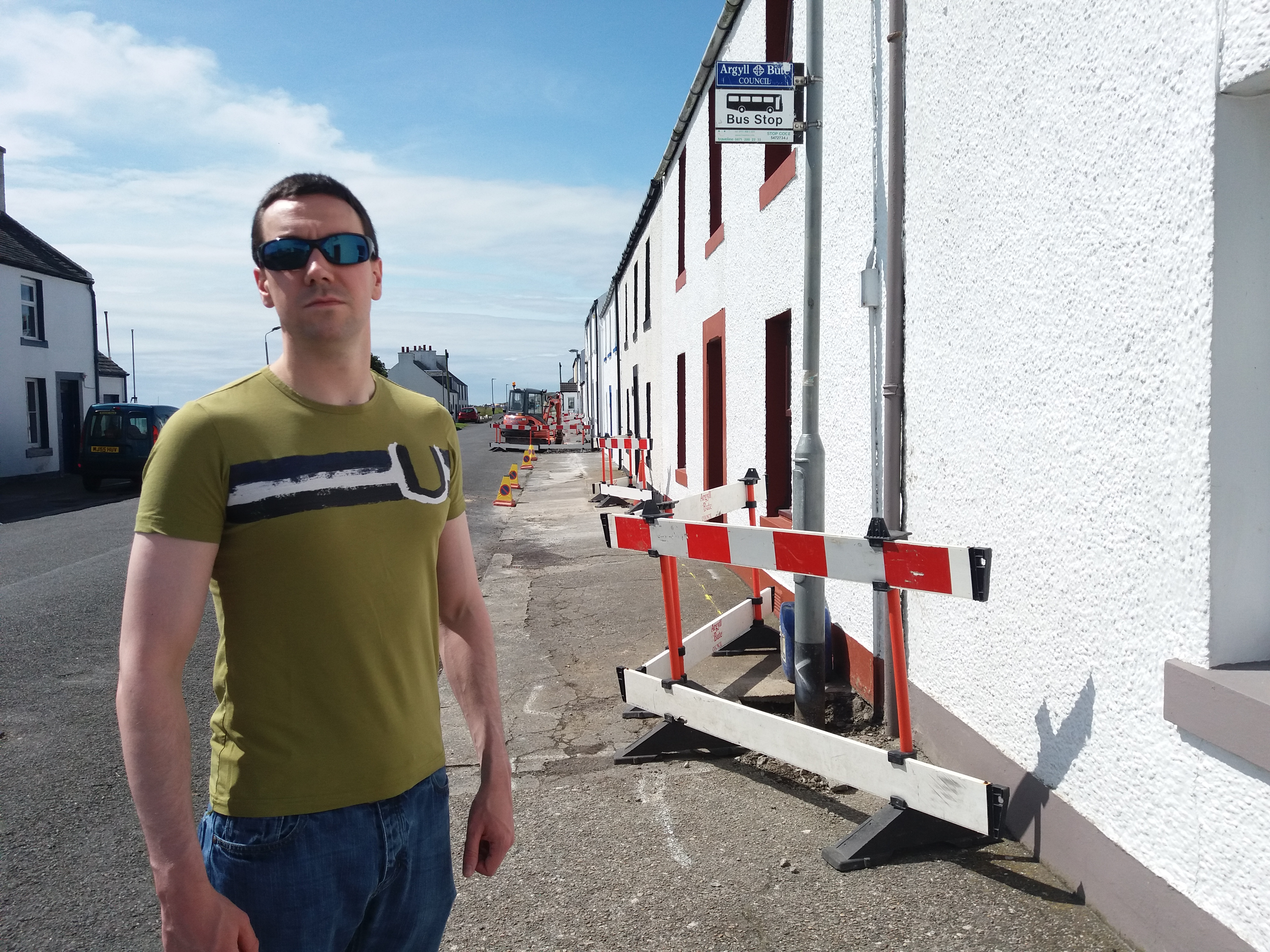 Councillor Alastair Redman beside one of the lighting schemes in Port Charlotte.
