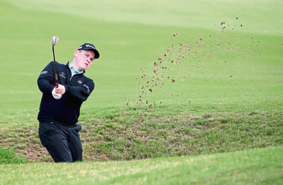Scotland's Robert MacIntyre in the bunker on the 12th hole during day two of the Aberdeen Standard Investments Scottish Open at The Renaissance Club, North Berwick.