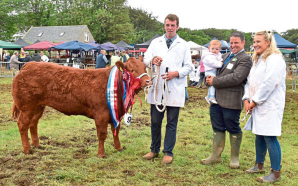 Champion of champions I'll Be There with William Moir, beef interbreed judge David Clark with daughter Katie, and Rebecca Stuart.