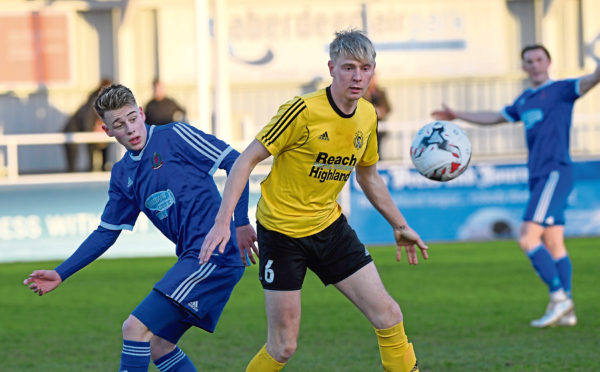 Press and Journal Highland League ;  Cove Rangers (blue) v Nairn County (yellow)  Pictured - Cove's Hamish MacLeod, Nairn's Adam Poritt.     Picture by Kami Thomson    24-04-18
