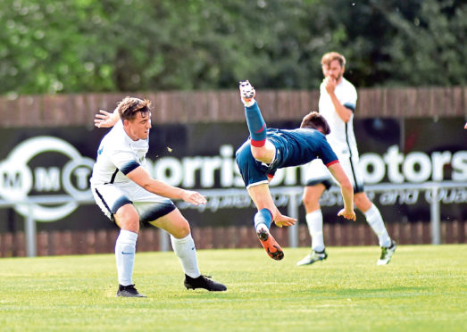 James McShane tackling Turriff United' Keir Smith.    Picture by Scott Baxter