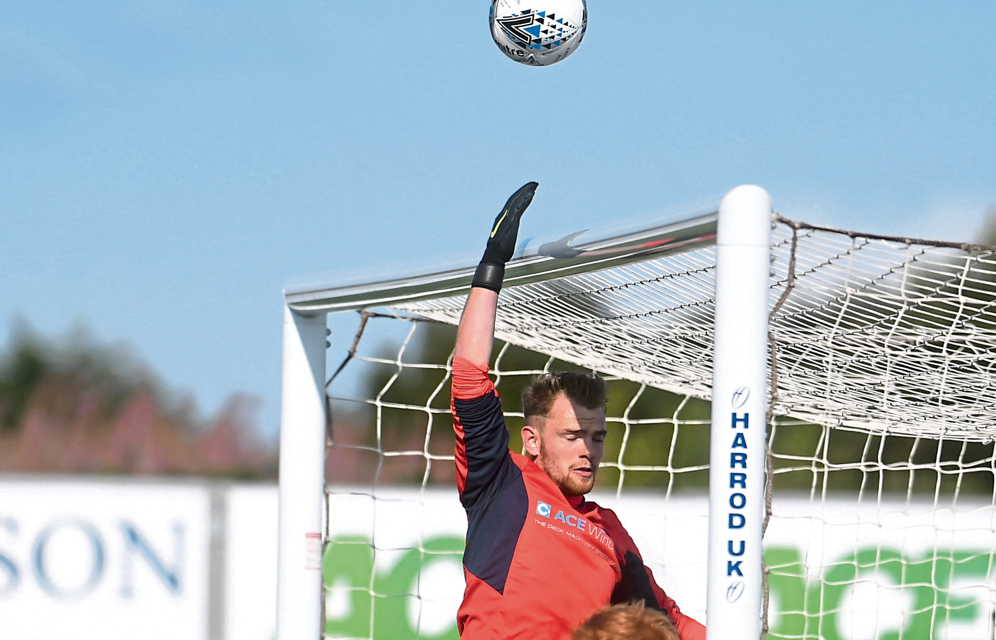 Turriff keeper Fraser Hobday clears a corner . Pic by Chris Sumner