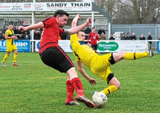 Breedon Scottish Highland League. Inverurie Loco Works (red) v Wick Academy (yellow) at Harlaw Park, Inverurie. Picture of (L-R) Colin Charlesworth and Gary Manson.  Picture by KENNY ELRICK     23/02/2019