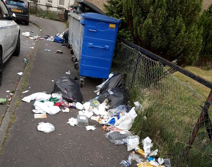 Overflowing bins on the Soroba Housing Estate