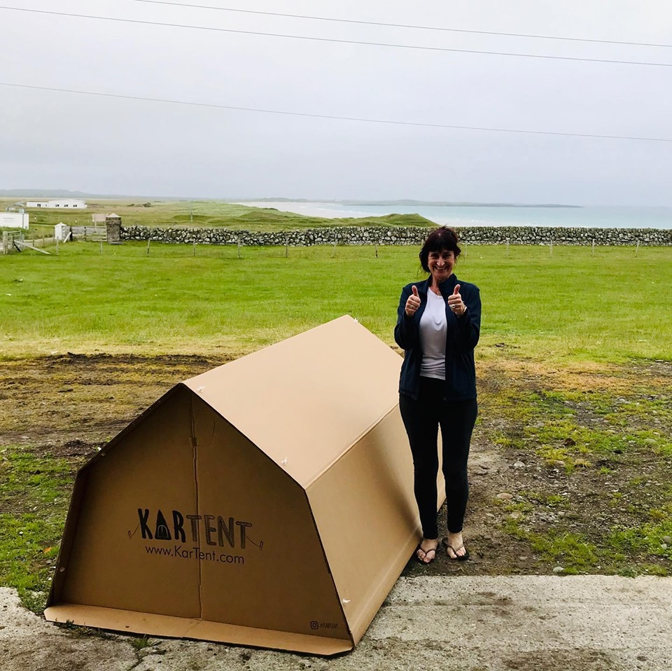 Ms MacLeod outside her first cardboard tent on Tiree.