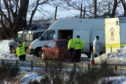 Police near huntly where man's body was found in a lane off the A96 in February 2001