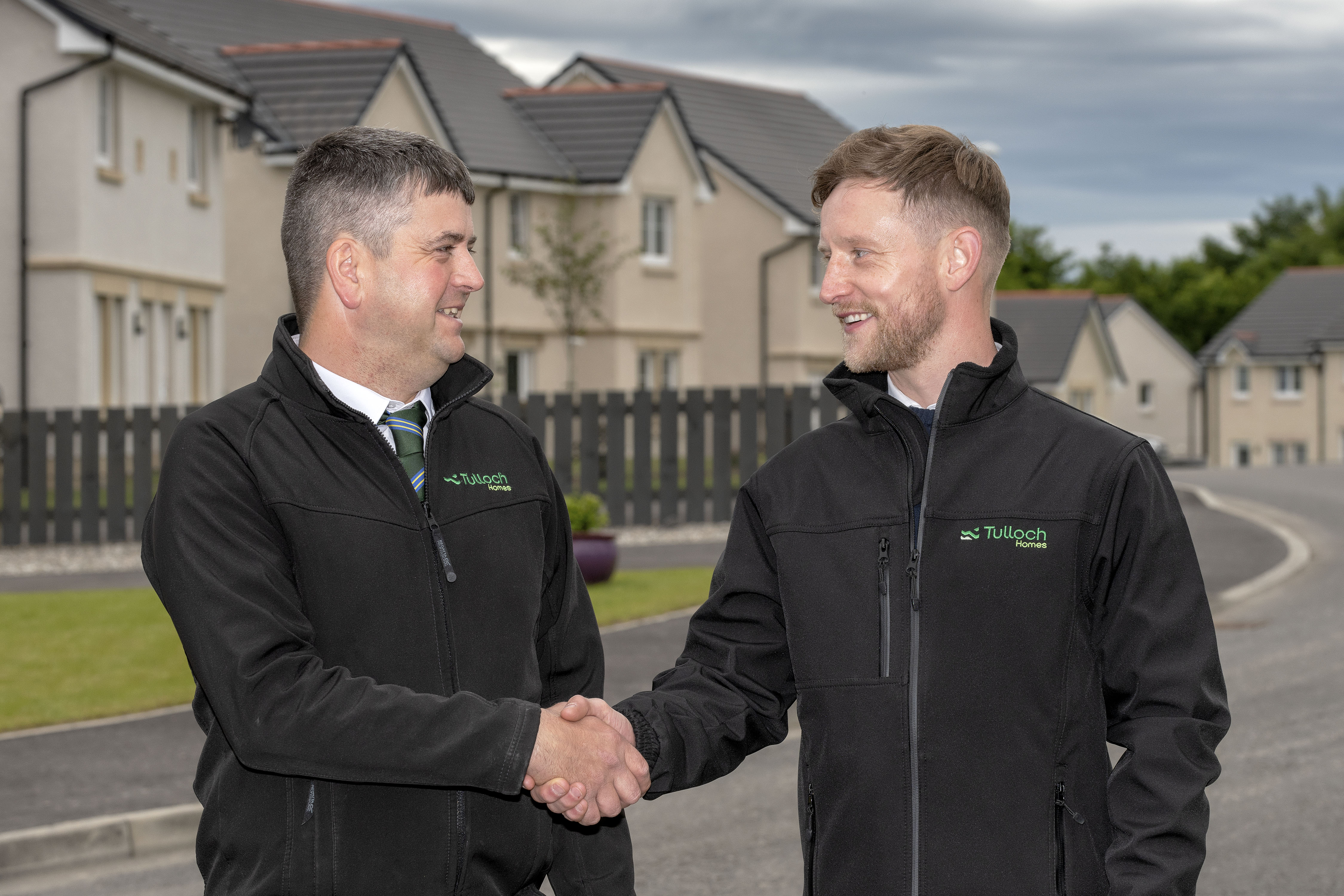 Zander Sutherland, right, is congratulated on his new award by assistant site manager George Johnstone.