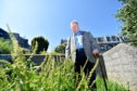 Cllr Bill Cormie claims that gardeners are only focusing on routes in Britain in Bloom competition. He will show the photographer the state of Short Loanings and nearby Leadside Road.  Pictured is Cllr Bill Cormie at Short Loanings.